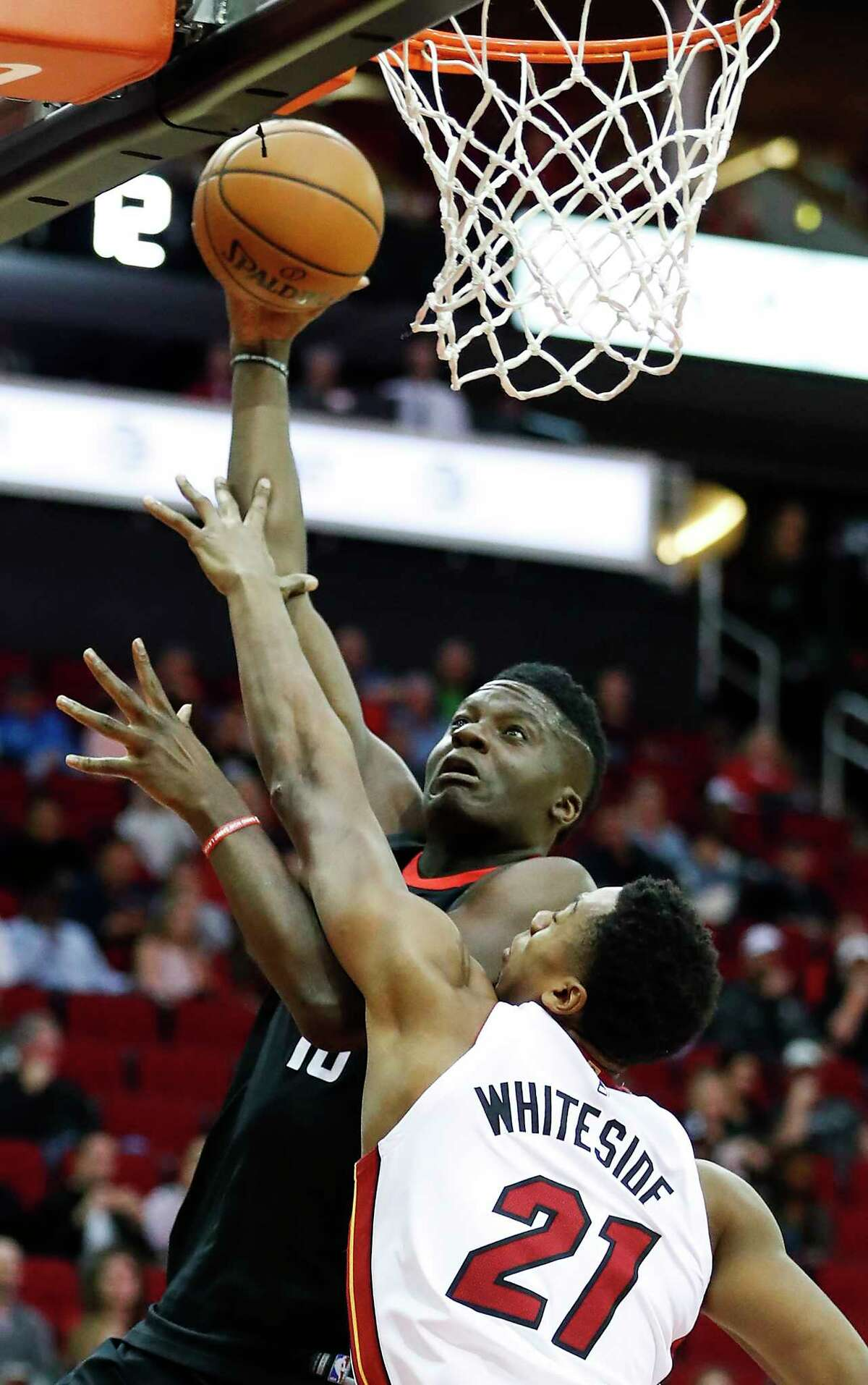 Houston Rockets center Clint Capela (15) shoots a layup over Miami Heat center Hassan Whiteside (21) during the first quarter of an NBA basketball game at Toyota Center on Monday, Jan. 22, 2018, in Houston.