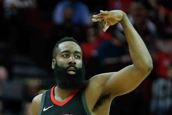Houston Rockets guard James Harden celebrates scoring a 3-pointer against the Miami Heat during the first quarter of an NBA basketball game at Toyota Center on Monday, Jan. 22, 2018, in Houston.