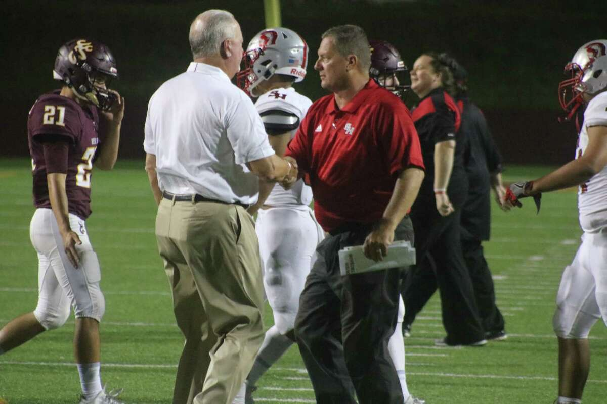 South Houston head coach Dwayne Lane (right) shakes hands with Deer Park head coach Chris Massey following their recent game. Lane was named the new head football coach at Clear Creek High School Monday night at a Clear Creek ISD board meeting.