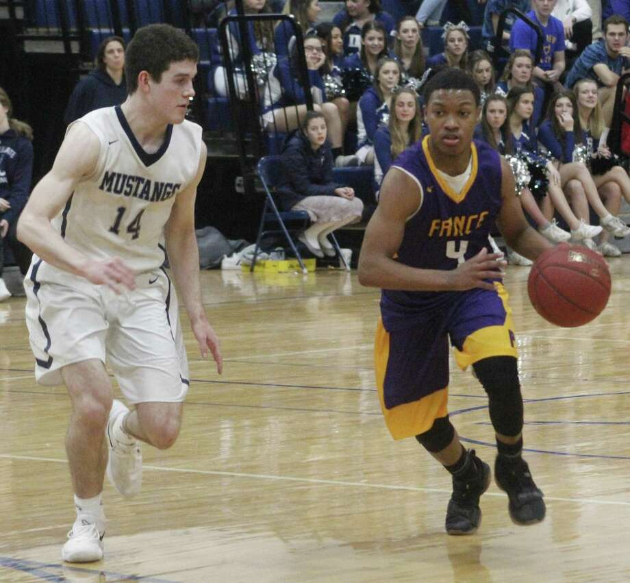 Prince Tech's Mike Best, right, dribbles the ball up the court as Immaculate's Ronan Doherty defends during the boys basketball game at Immaculate High School in Danbury Jan. 22, 2018. Photo: Richard Gregory / Richard Gregory