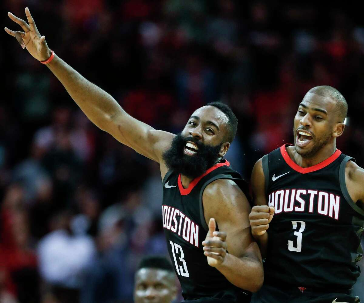 Houston Rockets guard James Harden (13) and guard Chris Paul (3) celebrate's Paul's 3-pointer against the Miami Heat during the fourth quarter of an NBA basketball game at Toyota Center on Monday, Jan. 22, 2018, in Houston.