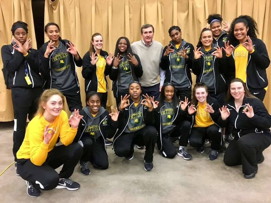 Midland College head women's basketball Ron Jones, top center, poses with his team after a 65-60 win at Western Texas College in Snyder that gave him 600 wins at the college. Courtesy photo