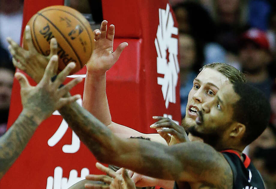 Back from a two-game suspension, the Rockets' Trevor Ariza, right, battles Miami's Kelly Olynyk for a rebound. Photo: Brett Coomer, Staff / © 2018 Houston Chronicle