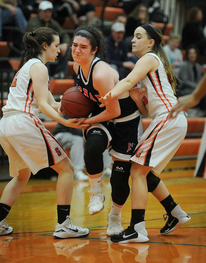 Foran's Jasmine Lord, center, fights through a double team of Shelton defenders during Monday night's game at Shelton High School. Foran defeated Shelton 42-32. For more information, see the high school roundup on B3. Photo: Brian A. Pounds / Hearst Connecticut Media / Connecticut Post