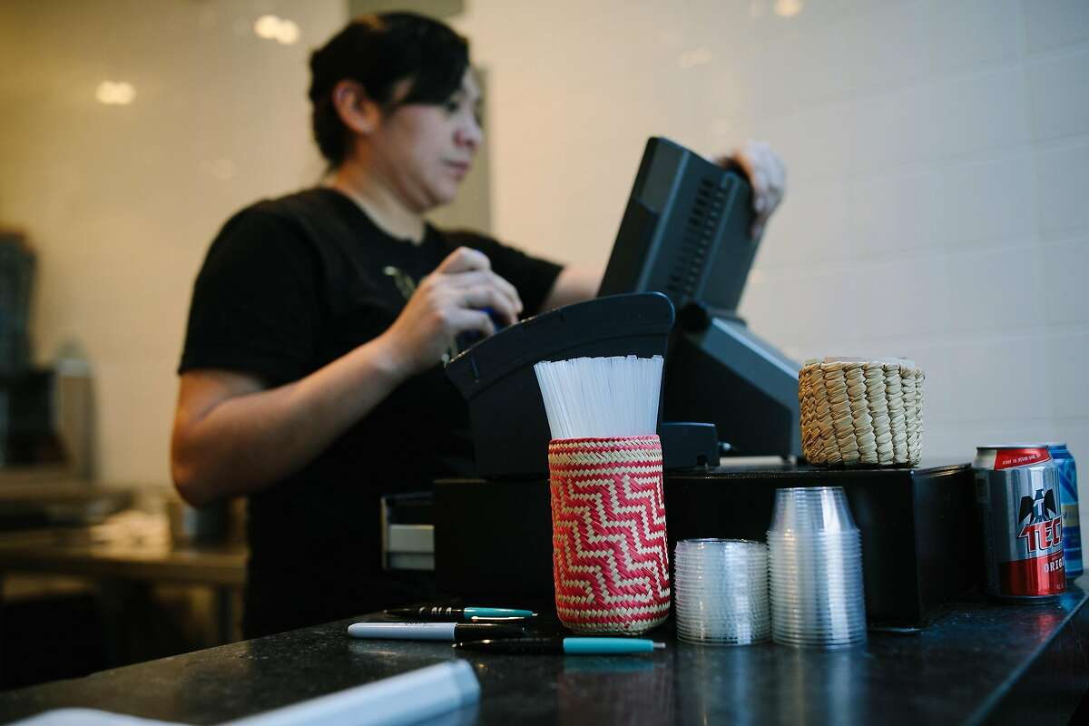 A container filled with compostable straws is seen at the cash register at Tacos Cala in San Francisco on Monday, Jan. 22, 2018. Take out restaurants such as Tacos Cala will not be affected by the new law.