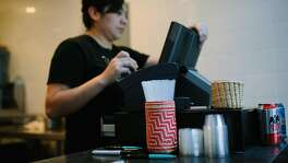 A straw container is seen at the cash register at Tacos Cala in San Francisco, Calif. Monday, Jan. 22, 2018.