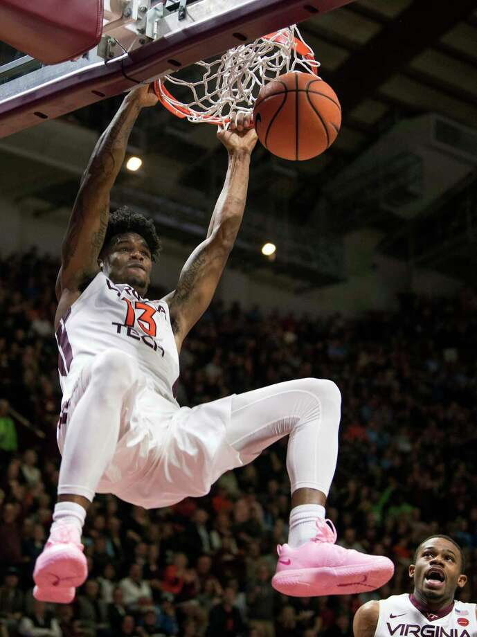 Virginia Tech's Ahmad Hill (13) dunks against North Carolina during the second half of an NCAA college basketball game in Blacksburg, Va. Monday, Jan. 22, 2018. (AP Photo/Lee Luther Jr.) Photo: Lee Luther Jr. / FR 171157 AP