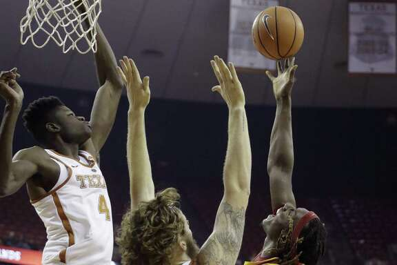 Texas big men Mo Bamba (left) and Dylan Osetkowski contest a shot by Iowa State forward Solomon Young.