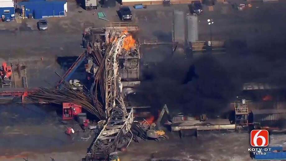 In this photo provided from a frame grab from Tulsa's KOTV/NewsOn6.com, fires burn at an eastern Oklahoma drilling rig near Quinton, Okla., Monday Jan. 22, 2018. Five people are missing after a fiery explosion ripped through a drilling rig, sending plumes of black smoke into the air and leaving a derrick crumpled on the ground, emergency officials said. (Christina Goodvoice, KOTV/NewsOn6.com via AP) Photo: Christina Goodvoice, MBR / KOTV/NewsOn6.com