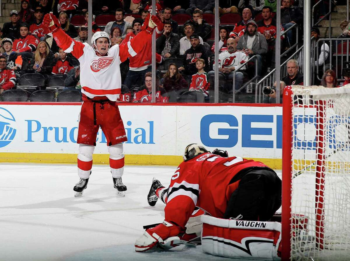 NEWARK, NJ - JANUARY 22: Dylan Larkin #71 of the Detroit Red Wings celebrates his goal in the third period as Cory Schneider #35 of the New Jersey Devils defends on January 22, 2018 at Prudential Center in Newark, New Jersey. (Photo by Elsa/Getty Images)