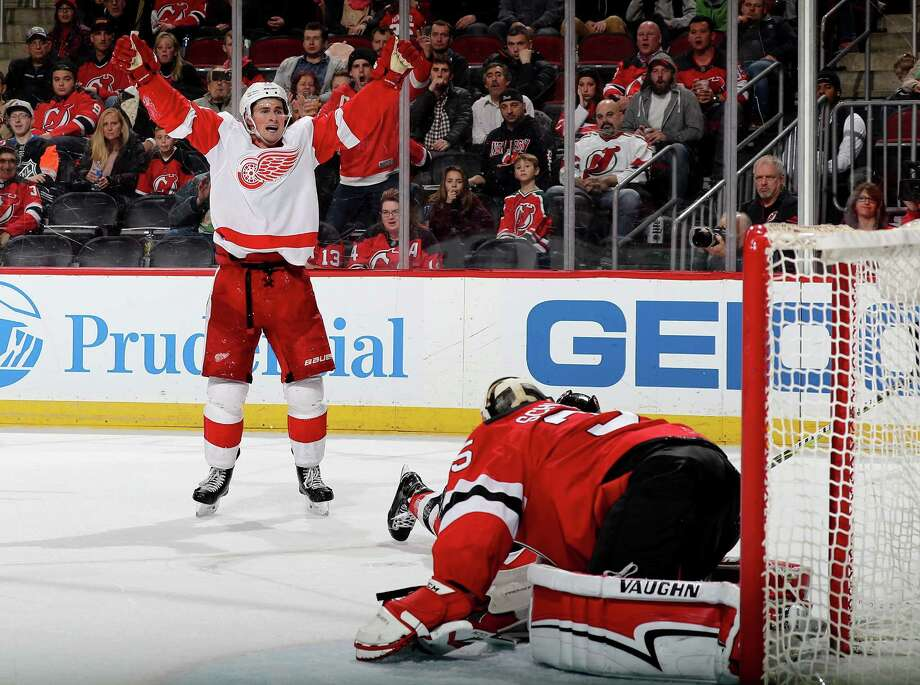 NEWARK, NJ - JANUARY 22:  Dylan Larkin #71 of the Detroit Red Wings celebrates his goal in the third period as Cory Schneider #35 of the New Jersey Devils defends on January 22, 2018 at Prudential Center in Newark, New Jersey.  (Photo by Elsa/Getty Images) Photo: Elsa / 2018 Getty Images