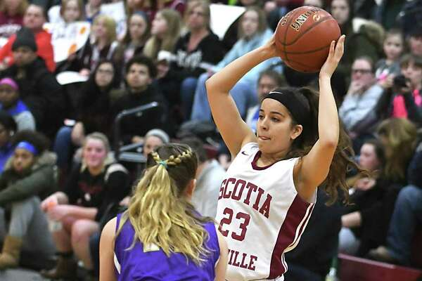 Scotia's Asia Winney drives looks to pass the ball while being guarded by Amsterdam's Lucia Liverio during a basketball game on Monday, Jan. 22, 2018 in Scotia, N.Y. (Lori Van Buren/Times Union)