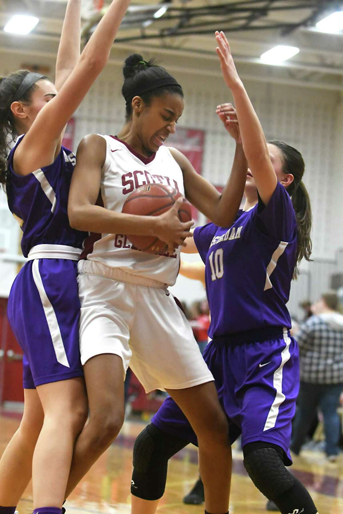 Scotia's Rhaymi Porter grabs a rebound and is surrounded by Amsterdam players during a basketball game on Monday, Jan. 22, 2018 in Scotia, N.Y. (Lori Van Buren/Times Union)