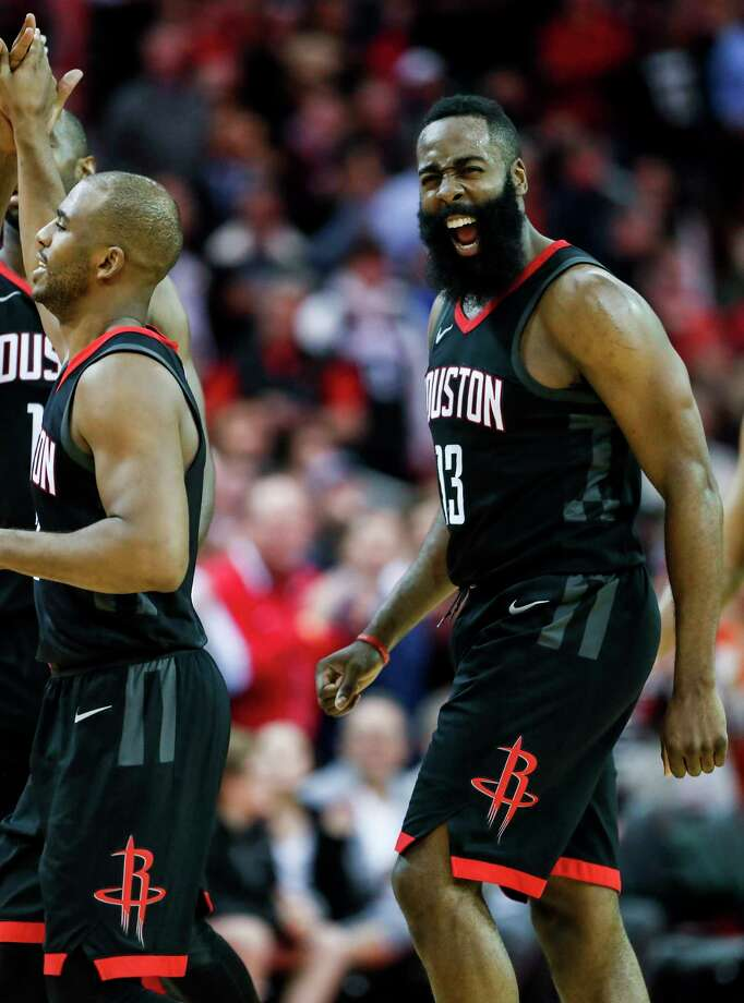 The points were hard to come by against the Heat on Monday night at Toyota Center, so Rockets guard James Harden, right, celebrated when teammate Chris Paul, left, sank a 3-pointer during the fourth quarter. Photo: Brett Coomer, Staff / © 2018 Houston Chronicle