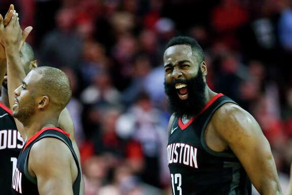 The points were hard to come by against the Heat on Monday night at Toyota Center, so Rockets guard James Harden, right, celebrated when teammate Chris Paul, left, sank a 3-pointer during the fourth quarter.