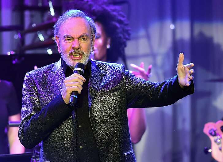 (FILES) This file photo taken on February 11, 2017 shows singer Neil Diamond performing during the annual Clive Davis pre-Grammy gala at the Beverly Hilton Hotel. Diamond announced on his website on January 22, 2018, he has been diagnosed with Parkinson's disease. He also announced his retirement.  / AFP PHOTO / Frederic J. BROWNFREDERIC J. BROWN/AFP/Getty Images