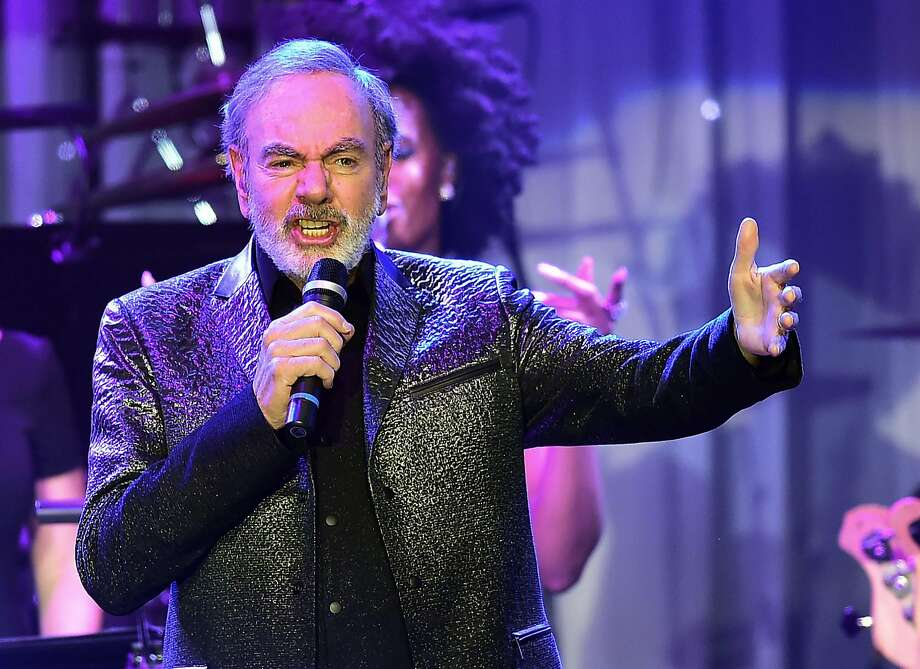 (FILES) This file photo taken on February 11, 2017 shows singer Neil Diamond performing during the annual Clive Davis pre-Grammy gala at the Beverly Hilton Hotel. Diamond announced on his website on January 22, 2018, he has been diagnosed with Parkinson's disease. He also announced his retirement.  / AFP PHOTO / Frederic J. BROWNFREDERIC J. BROWN/AFP/Getty Images Photo: FREDERIC J. BROWN, AFP/Getty Images