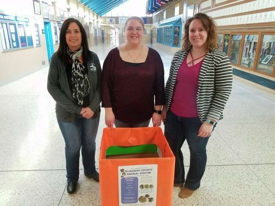 From left, Sandy Russell, Ali Lewis and Anna McNeill place a box in Gladwin High School on Friday for donations for the Gladwin County Animal Shelter. The boxes will be in the high schools and select businesses around the county until Feb. 2. They, along withPeggy Vanderhagen, are doing the project for Gladwin County Leadership. (Tereasa Nims/for the Daily News)