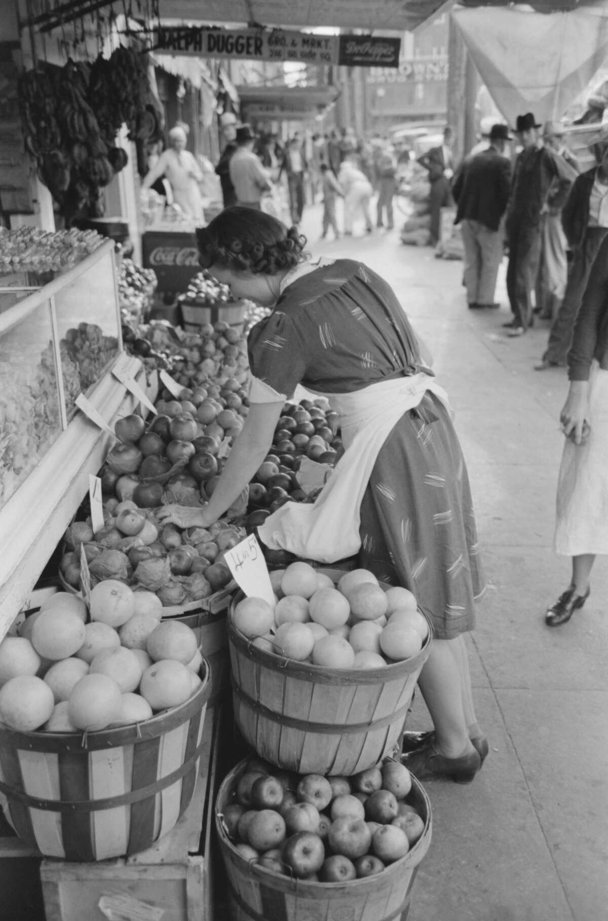 Saleswoman at Grocery Store, Waco, Texas, USA, Russell Lee, November 1939. (Photo by: Universal History Archive/UIG via Getty Images)