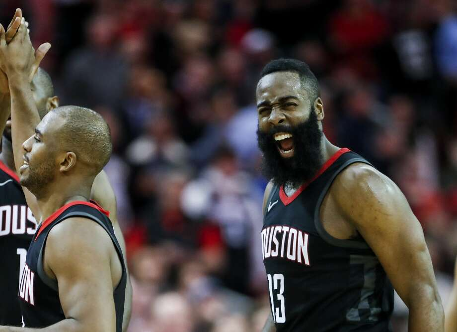 Houston Rockets guard James Harden (13) and guard Chris Paul (3) celebrate's Paul's 3-pointer against the Miami Heat during the fourth quarter of an NBA basketball game at Toyota Center on Monday, Jan. 22, 2018, in Houston. ( Brett Coomer / Houston Chronicle ) Photo: Brett Coomer/Houston Chronicle
