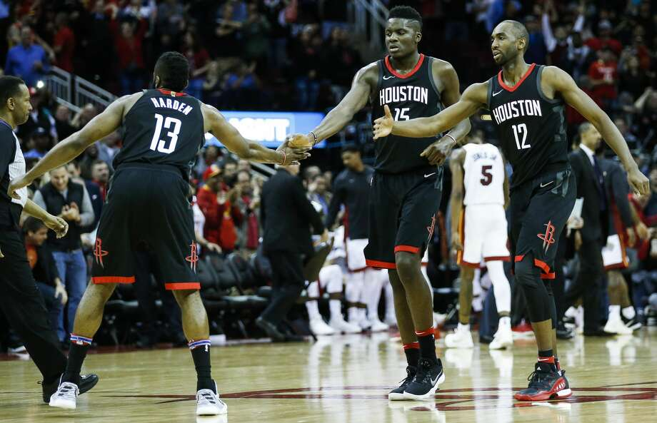 Houston Rockets guard James Harden (13), center Clint Capela (15) and forward Luc Mbah a Moute (12) slap hands after the Rockets took a lead during the fourth quarter of an NBA basketball game against the Miami Heat  at Toyota Center on Monday, Jan. 22, 2018, in Houston. ( Brett Coomer / Houston Chronicle ) Photo: Brett Coomer/Houston Chronicle