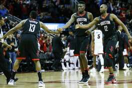 Houston Rockets guard James Harden (13), center Clint Capela (15) and forward Luc Mbah a Moute (12) slap hands after the Rockets took a lead during the fourth quarter of an NBA basketball game against the Miami Heat  at Toyota Center on Monday, Jan. 22, 2018, in Houston. ( Brett Coomer / Houston Chronicle )