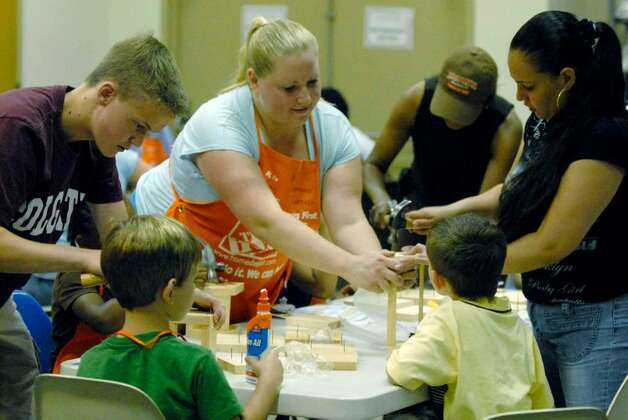 Participants take part in a Home Depot bird house building workshop at the Albany Public Library Thursday. ( Michael P. Farrell / Times Union ) Photo: MICHAEL P. FARRELL / 00004744A