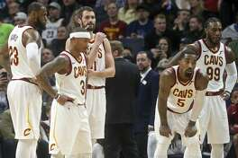 FILE - In this Monday, Jan. 8, 2018, file photo, Cleveland Cavaliers players, from left, LeBron James, Isaiah Thomas, Kevin Love, JR Smith and Jae Crowder take a break during a review in the second half of an NBA basketball game against the Minnesota Timberwolves in Minneapolis. James and the Cavaliers are going through their annual January freeze. It's taking them longer to thaw this year, raising questions about whether they're still the best team in the Eastern Conference or good enough to make their fourth straight NBA Finals. (AP Photo/Jim Mone, File)
