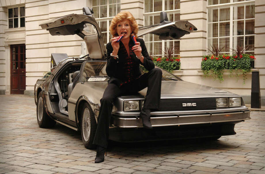 Rula Lenska relaunches the Wispa Chocolate bar with the help of the Back to the Future DeLorean car, at Chancery Court Hotel in central London. Rula starred in the original Wispa adverts with Dennis Waterman. Photo: Joel Ryan - PA Images/PA Images Via Getty Images