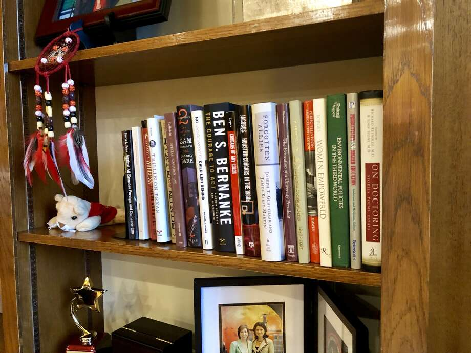 Bookshelves line UH President Renu Khator's office. Here's a sampling of what's on one of them.