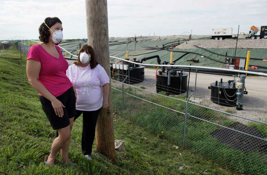 Dawn Chapman (left) and Karen Nickel wear protective masks at the West Lake Landfill northwest of St. Louis in June. The two women and other residents and local activists are pressing the Environmental Protection Agency for extensive excavation of the Superfund site, which contains radioactive waste. Photo: Washington Post Photo By Linda Davidson / The Washington Post