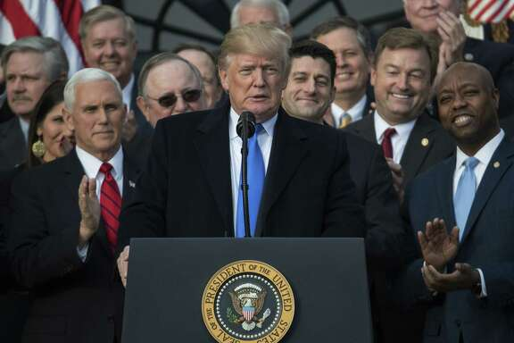 President Donald Trump, joined by Vice President Mike Pence, House Speaker Paul Ryan and other members of Congress, celebrates the passage of tax overhaul legislation. A reader says the bill isn't slanted to the rich, as Democrats maintain.