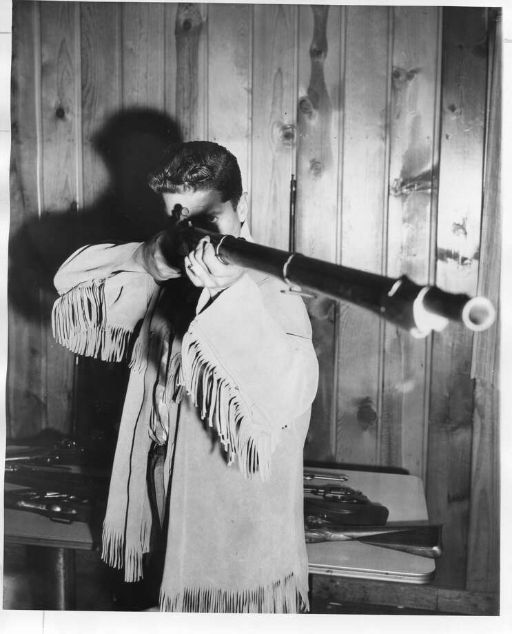 Ernie Allen sights in an 1834 Milbury musket, used extensively during the Civil War. This particular rifle has been converted from flint to percussion. July 1961 Photo: Daily News File Photo