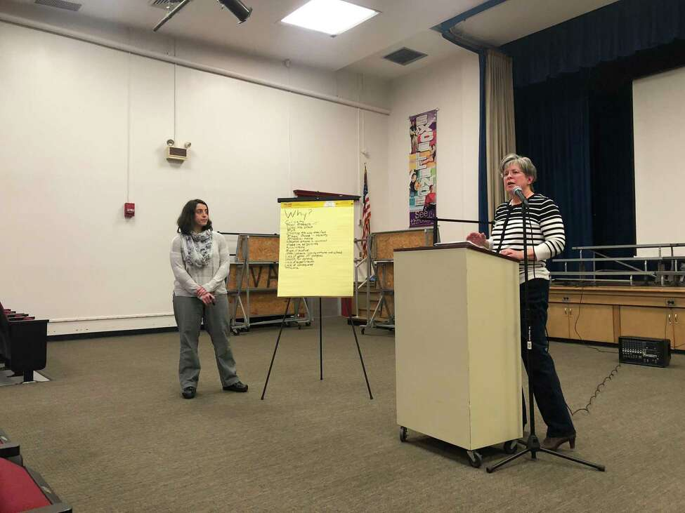 Jeanne Sosnow, president of the Niskayuna Community Action Program, asked audience members why teenagers drink alcohol and do drugs at Van Antwerp Middle School on Jan. 22, 2018. (Massarah Mikati/Times Union)