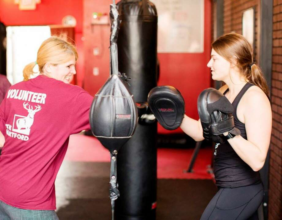 Approximately 50 employees of The Hartford worked out at 9Round Middletown Saturday during a HartMob, one of the events that show appreciation for the insurer's small business customers. Photo: Roxbury Photography