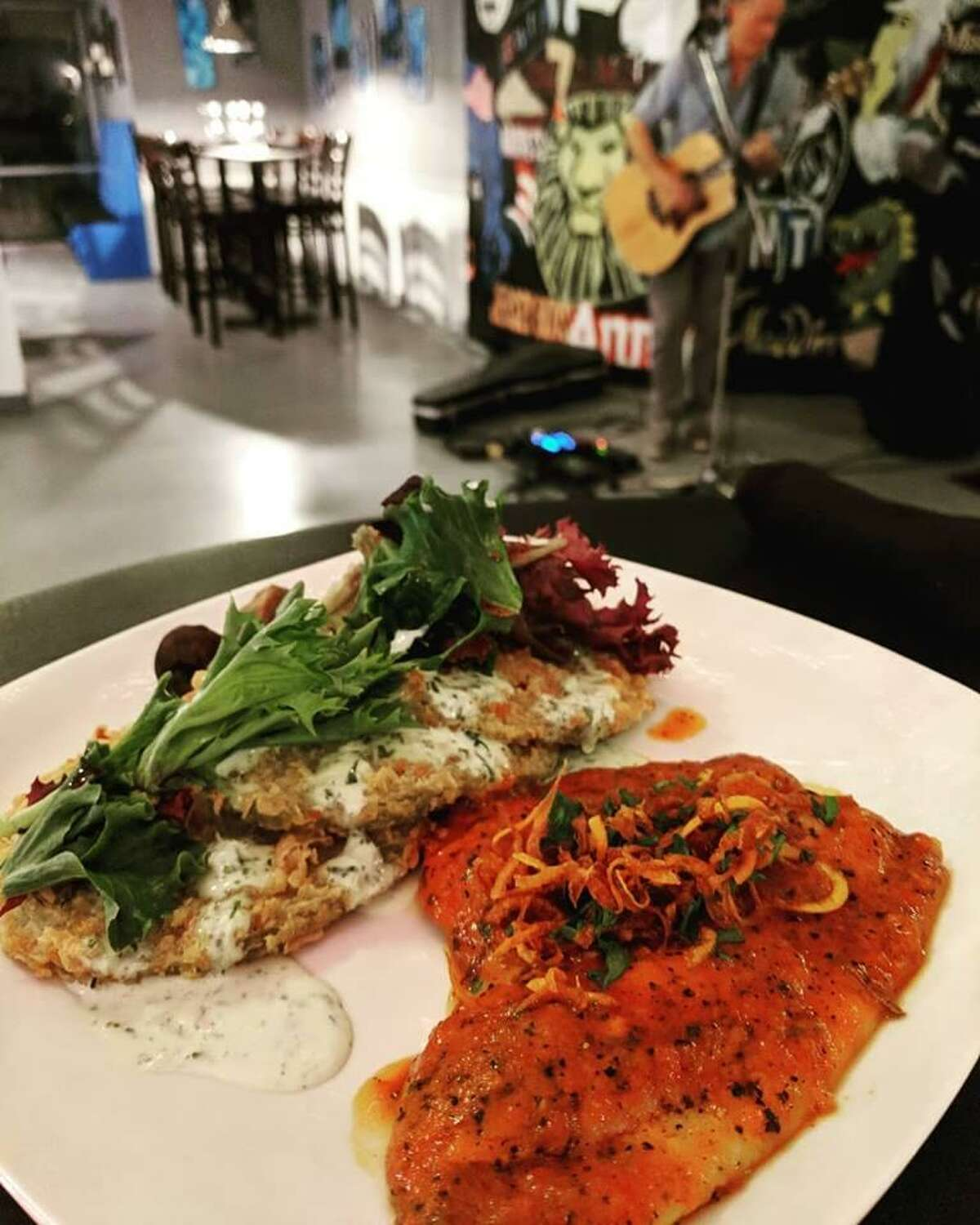 Salt block-seared flounder and fried green tomatoes at Sylver Spoon, a new restaurant and theater at 6700 N. Interstate 35 in New Braunfels.