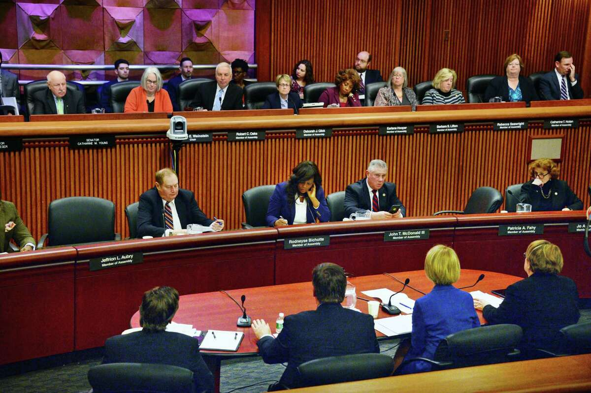 State University of New York Chancellor Kristina Johnson and her staff, foreground, appear before a New York state Legislature joint budget hearing Tuesday Jan. 23, 2018 in Albany, NY. (John Carl D'Annibale/Times Union)