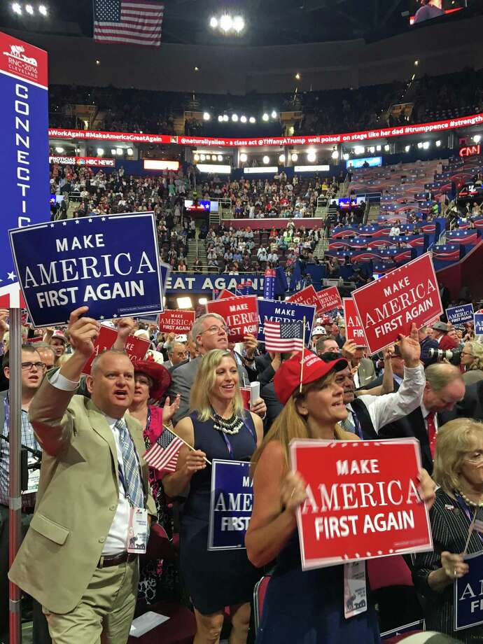 It was another night of stumping and speeches Wednesday, July 20, 2016, at the Republican National Convention in Cleveland. From left are Derek Phelps of Killingworth in the tan suit, Susan Hatfield of Pomfret in the blue dress holding the American flag, Michael Mason of Greenwich wearing glasses and standing behind Hatfield, Annalisa Stravato of Wilton, vice chair of the Connecticut GOP, wearing a red hat, and Ansonia Mayor David Cassetti standing next to Stravato. Photo: Neil Vigdor / Hearst Connecticut Media / Connecticut Post