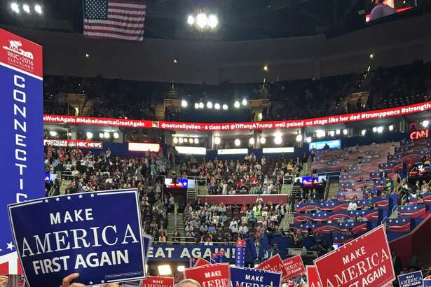 It was another night of stumping and speeches Wednesday, July 20, 2016, at the Republican National Convention in Cleveland. From left are Derek Phelps of Killingworth in the tan suit, Susan Hatfield of Pomfret in the blue dress holding the American flag, Michael Mason of Greenwich wearing glasses and standing behind Hatfield, Annalisa Stravato of Wilton, vice chair of the Connecticut GOP, wearing a red hat, and Ansonia Mayor David Cassetti standing next to Stravato.