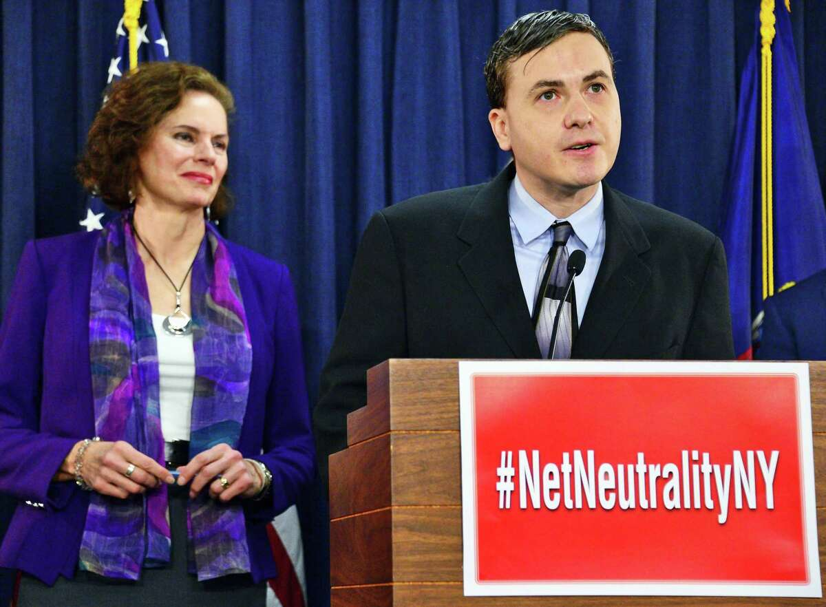 Richard Zack of the Troy-based Our.News speaks during a news conference on enforcing net neutrality in New York State Tuesday Jan. 23, 2018 in Albany, NY. At left is co sponsor of legislation Assemblymember Patricia Fahy. (John Carl D'Annibale/Times Union)