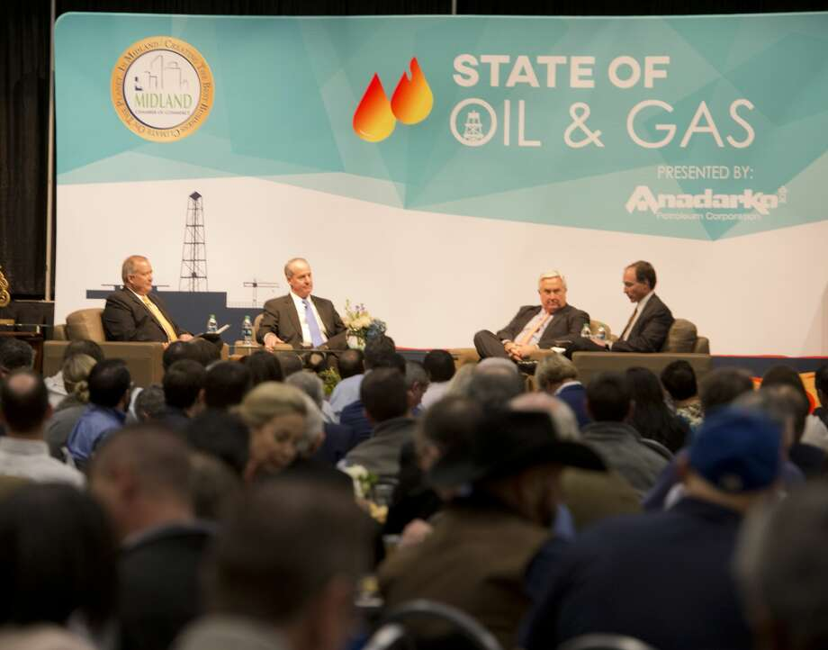 Travis Stice, Director & CEO Diamondback Energy, Jody Elliott, President Oxy Oil & Gas and Tim Dove President & CEO Pioneer Natural Resources, talk with Steven Pruett President & CEO Elevation Resources LLC 01/23/18 at the inaugural State of Oil & Gas put on by the Midland Chamber of Commerce.  Tim Fischer/Reporter-Telegram Photo: Tim Fischer/Midland Reporter-Telegram