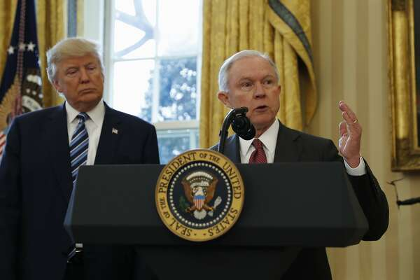 FILE - In this Feb. 9, 2017, file photo, President Donald Trump listens as Attorney General Jeff Sessions speaks in the Oval Office of the White House in Washington, after Vice President Mike Pence administered the oath of office to Sessions. Late last year, lawyers for Trump expressed optimism that special counsel Robert Mueller was nearing the end of his probe of Russia�s interference in the 2016 election. But if there was hope in the White House that Trump might be moving past an investigation that has dogged his presidency from the start, 2018 is beginning without signs of abatement. (AP Photo/Pablo Martinez Monsivais, File)