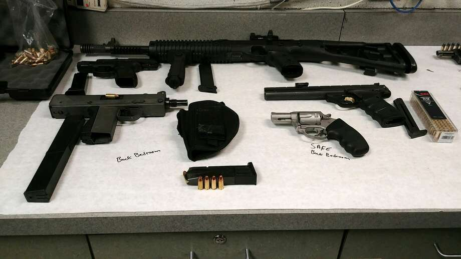 On Friday, police said authorities used a search warrant to raid a Linden Avenue residence where they found the marijuana, 62 grams of ketamine, four handguns, an assault rifle and a Mack-10 machine gun, along with about 150 rounds of ammunition. Authorities said they also confiscated $4,000. Photo: Troy Police Department