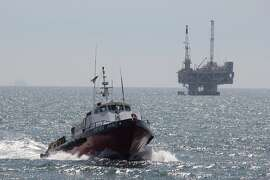 FILE- This May 16, 2015, photo shows a service boat carrying workers back to shore from a platform off Seal Beach, Calif. Opposition to the Trump administration's plan to expand offshore drilling mounted Wednesday, Jan. 10, 2018. The plan could open up federal waters off the California coast for the first time in more than three decades. The Channel is one of those areas that could open up. (AP Photo/John Antczak)