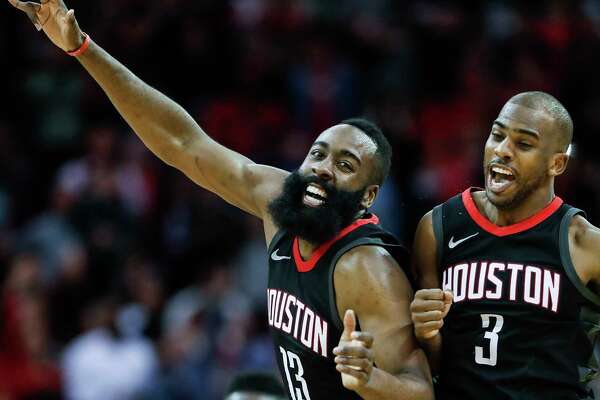 Houston Rockets guard James Harden (13) and guard Chris Paul (3) celebrate's Paul's 3-pointer against the Miami Heat during the fourth quarter of an NBA basketball game at Toyota Center on Monday, Jan. 22, 2018, in Houston. ( Brett Coomer / Houston Chronicle )