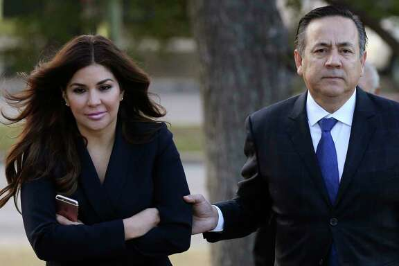 Texas State Sen. Carlos Uresti and his wife, Lleanna, arrive at the John H. Wood Jr. Federal Courthouse for the second day of his criminal trial, Tuesday, Jan. 23, 2018. The San Antonio Democrat and co-defendant Gary Cain face various fraud charges in connection with their roles at FourWinds Logistics, which bought and sold sand used in fracking to extract oil and gas from shale rock.