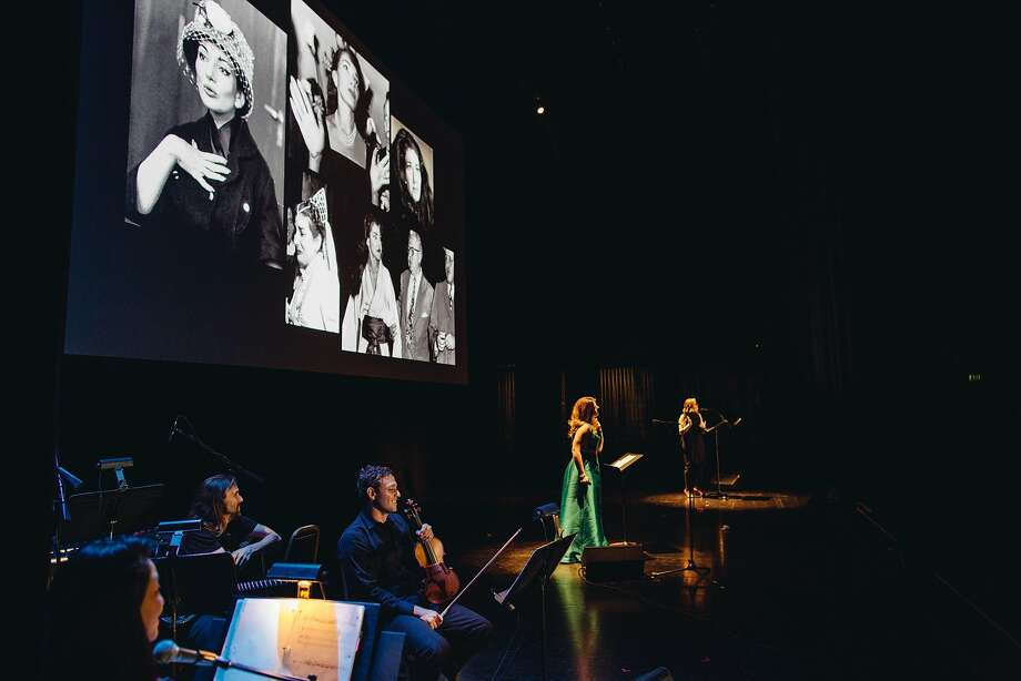 Singer Emily Birsan, center, and narrator Robin Amer with the Magik*Magik Orchestra at a Pop-Up Magazine show at the Paramount Theatre in Oakland. Photo: Erin Brethauer