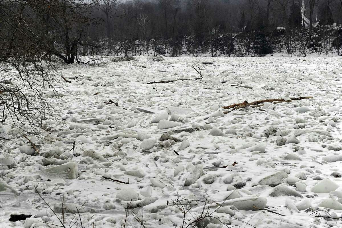 Although there is melting in some areas, big junks of ice continue to jam parts of the Housatonic River on Route 7 in Kent Monday, January 22,2018.