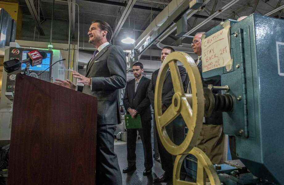 Dave Davis, president and COO of Simmons Machine and Tool Corporation speaks after the announcement of the establishment of Manufacturing Technology Pathways, a collaboration between HVCC and Center for Economic Growth at a press conference held in an industrial lab on the Hudson Valley Community College Thursday Oct. 26, 2017 in Troy, N.Y.  (Skip Dickstein/ Times Union) Photo: SKIP DICKSTEIN / 20041953A