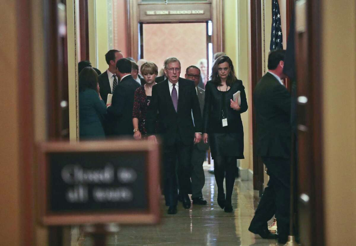 Senate Majority Leader Mitch McConnell of Ky., center, walks with members of his staff following the conclusion of a close-door meeting with fellow GOP Senators, Monday. Yes, they reached a deal to reopen the government, but the fact is the shutdown happened and shouldn't have.